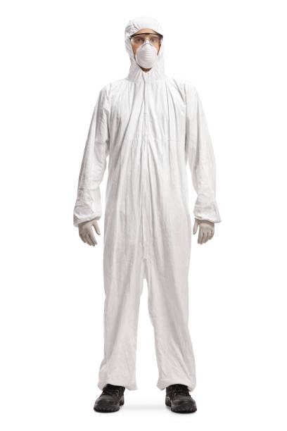 man in a white hazmat suit and mask - tuta protettiva foto e immagini stock