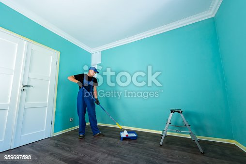 istock Man in a working overall 959697598