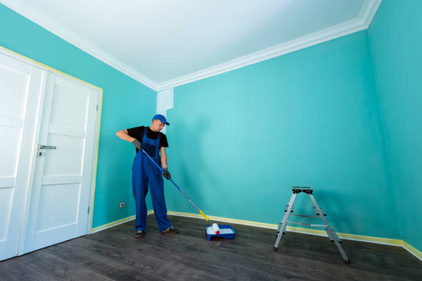 man in a working overall - painter stock photos and pictures