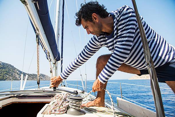 man in action of pulling rope - seemann thema stock-fotos und bilder