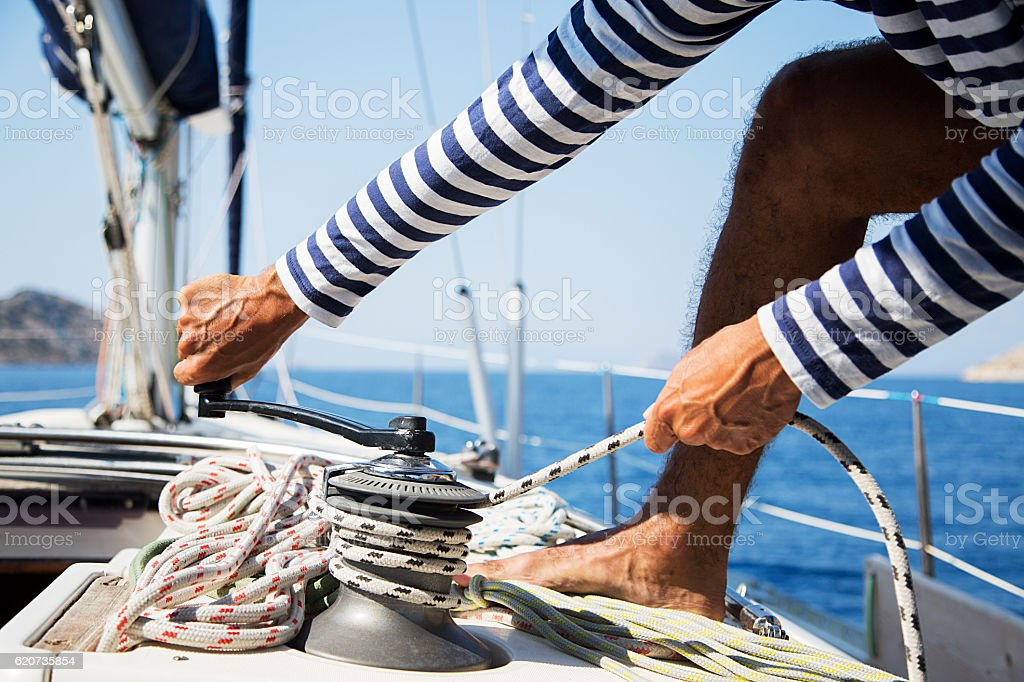 Man in action of pulling rope stock photo