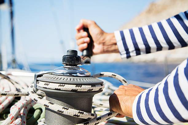 man in action of pulling rope - nautische seil stock-fotos und bilder