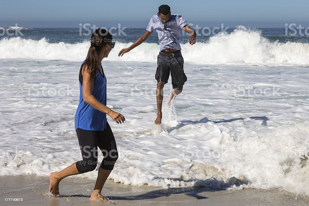 Man in Air as He Splashes Woman stock photo