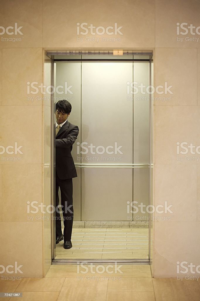 Man in an elevator royalty-free stock photo