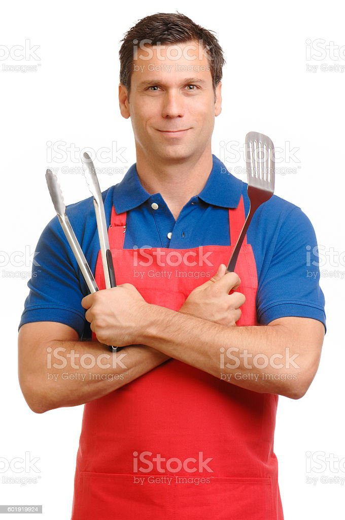 Man in apron with cooking utensils on white – Foto