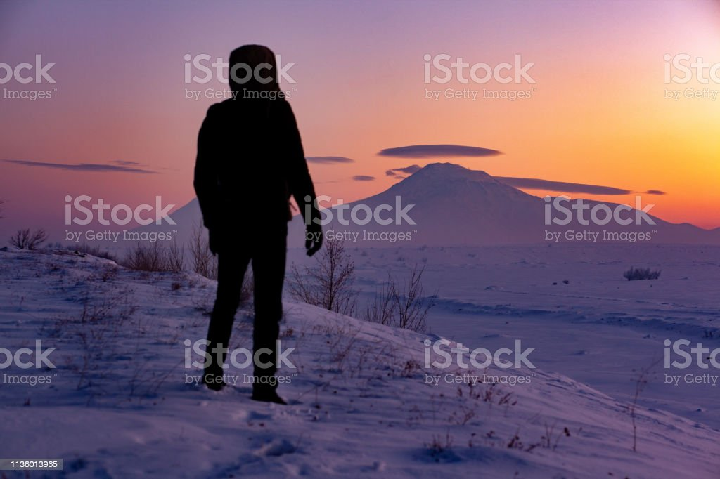 man in ararat snowy mountain stock photo
