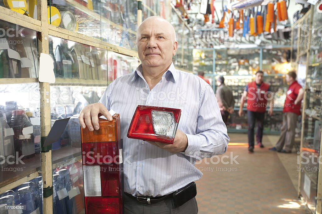 man  in  auto parts store stock photo
