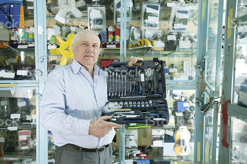 man   in  auto parts store royalty-free stock photo