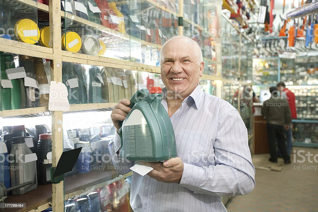 man  in auto store stock photo