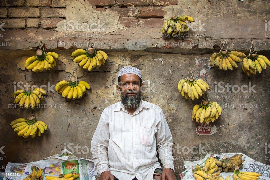 Man in Bangladesh selling banana stock photo