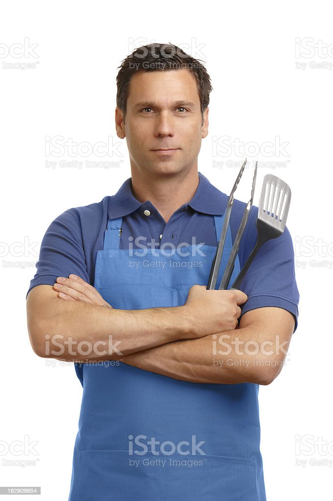 Man in barbecue apron with cooking utensils on white​​​ foto