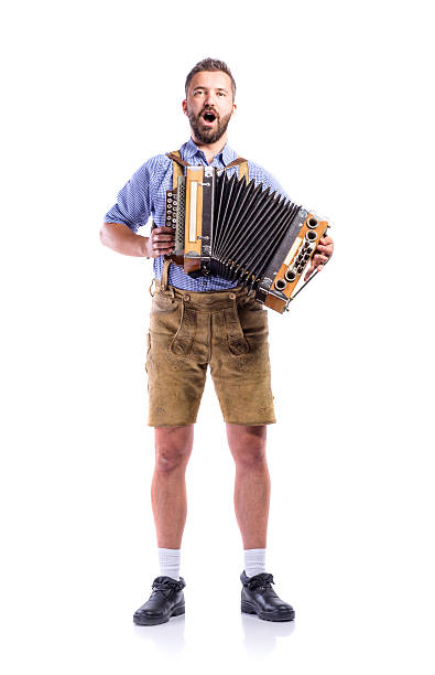 Man in bavarian clothes playing accordion and singing. Oktoberfe stock photo