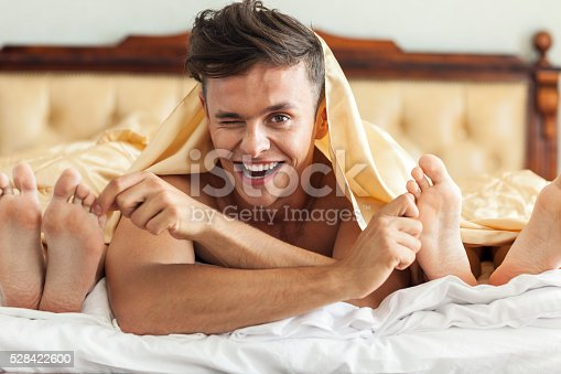 528422658 istock photo Man In Bed With Two Women 528422600