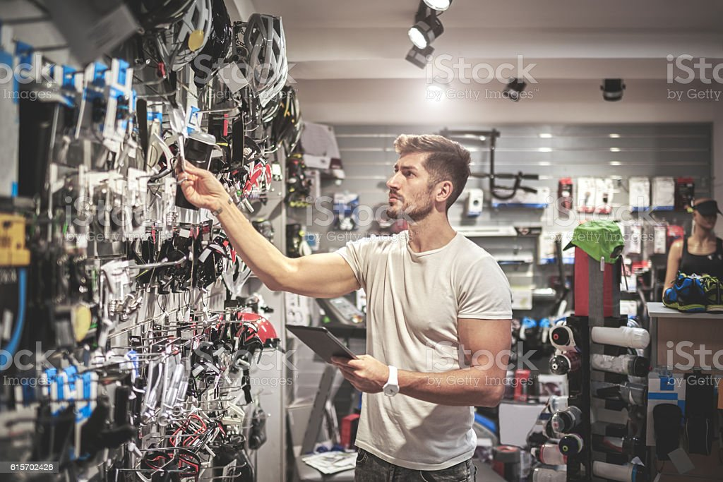 Man in bicycle store stock photo