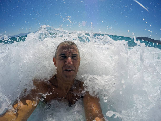 Man In Big Sea Wave stock photo