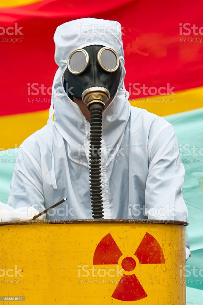A man in bio-hazard suit and gas mask. stock photo