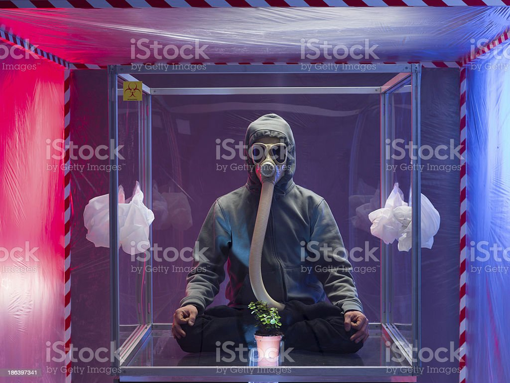 Man in biohazard suit and mask royalty-free stock photo