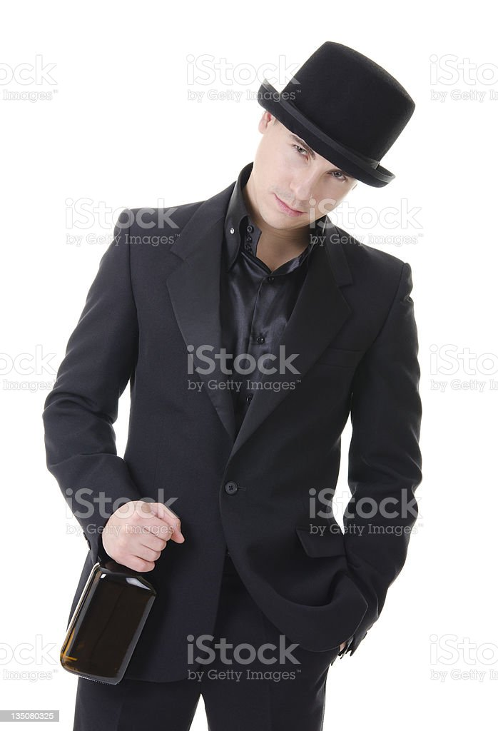 Man in black austere suit and hat with whisky royalty-free stock photo