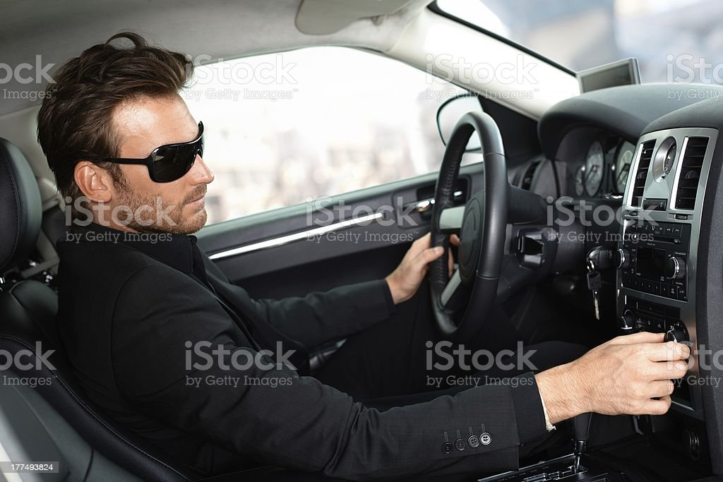 Man in black driving luxury car royalty-free stock photo