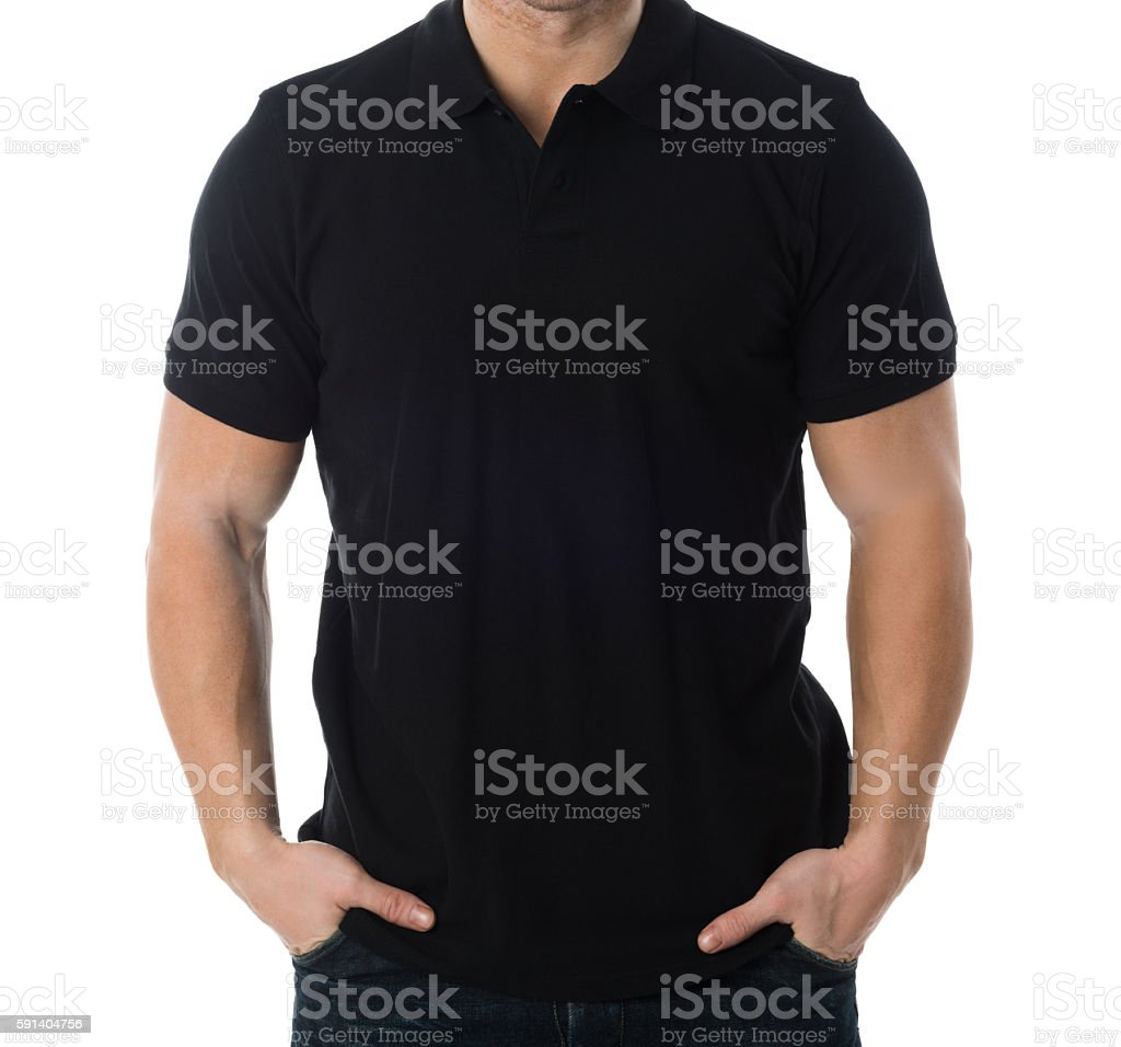 Man In Black Tshirt Standing Against White Background stock photo