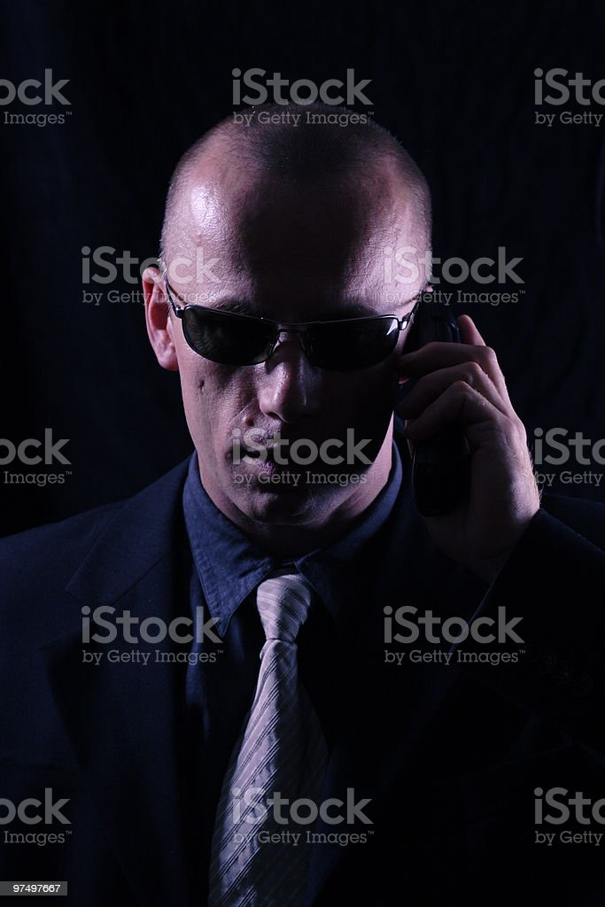 Man in black with phone royalty-free stock photo