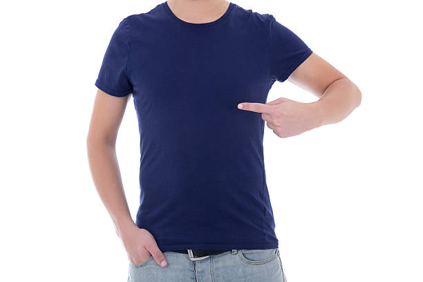 man in blank blue t-shirt pointing at himself stock photo