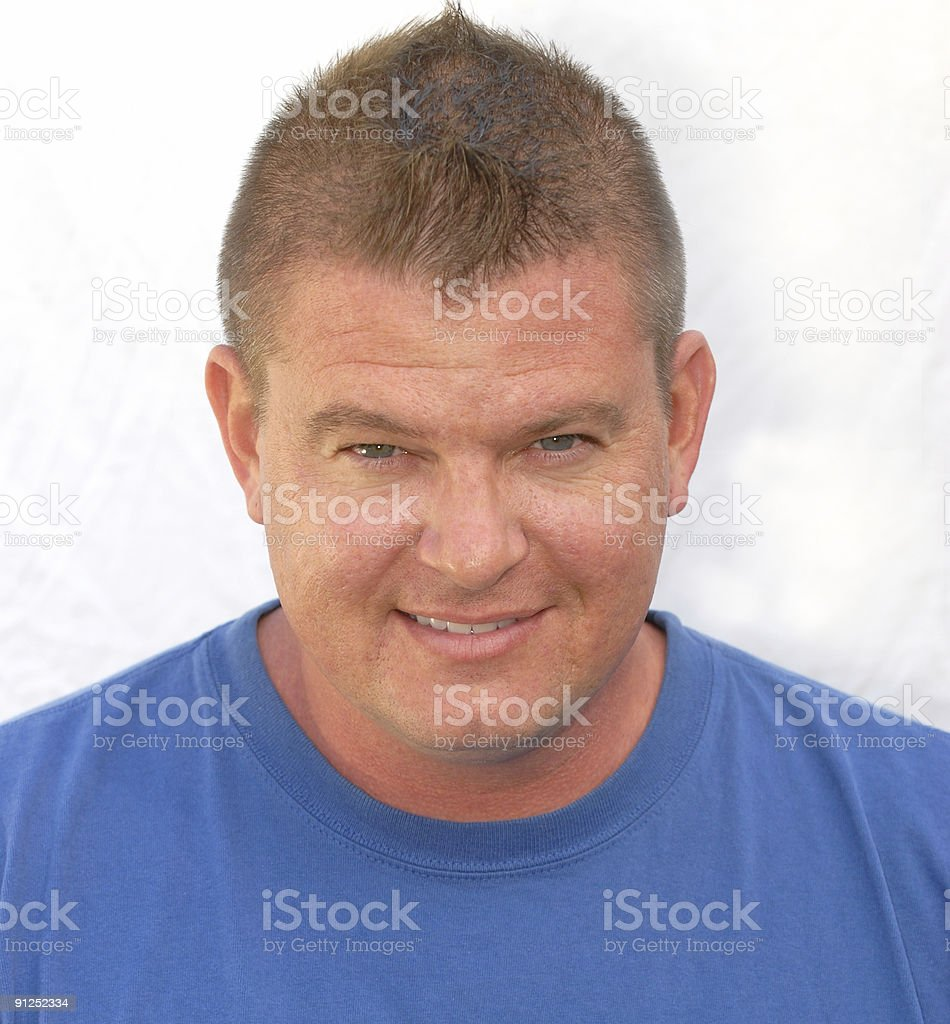 Man in blue t-shirt stock photo
