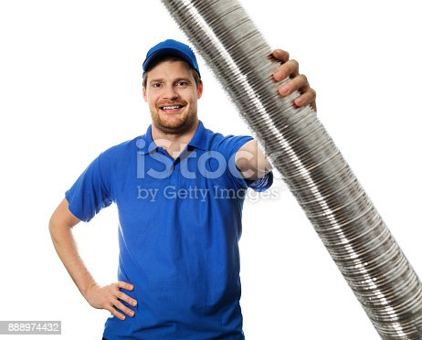 895571294 istock photo man in blue uniform with flexible aluminium ducting tube in hand 888974432