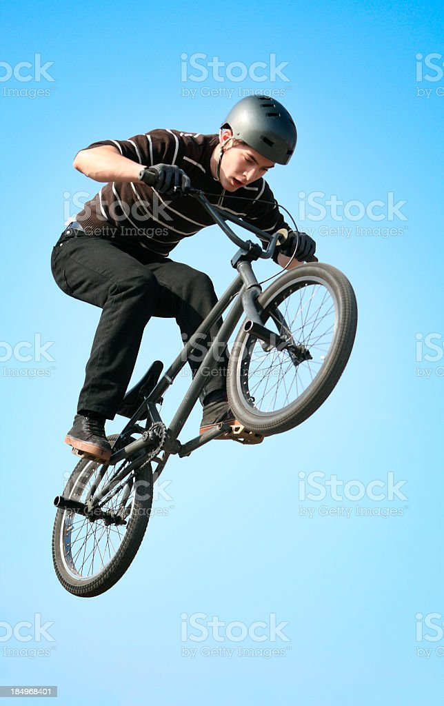 Man in BMX acrobatic action wearing a helmet stock photo