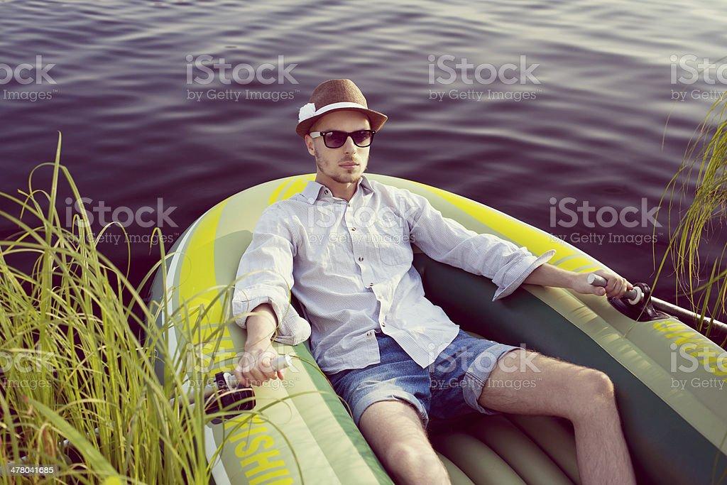 Man in board on lake stock photo
