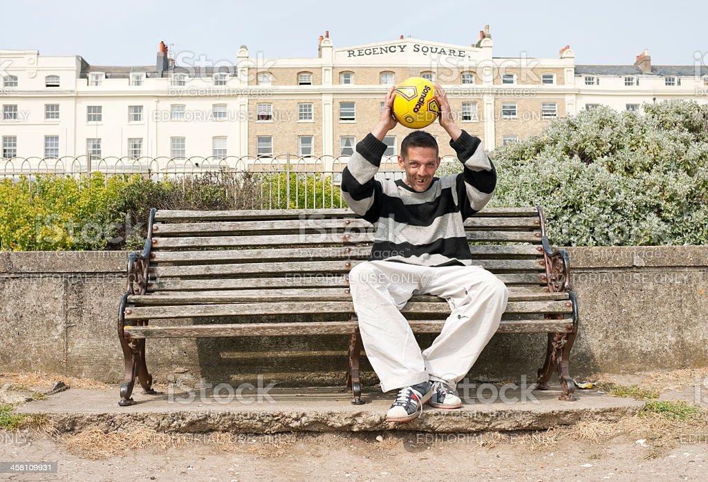 Man in Brighton Park, UK stock photo