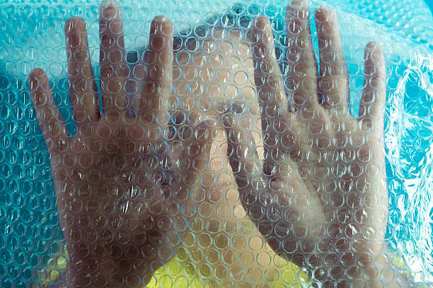 Man in Bubble Wrap stock photo