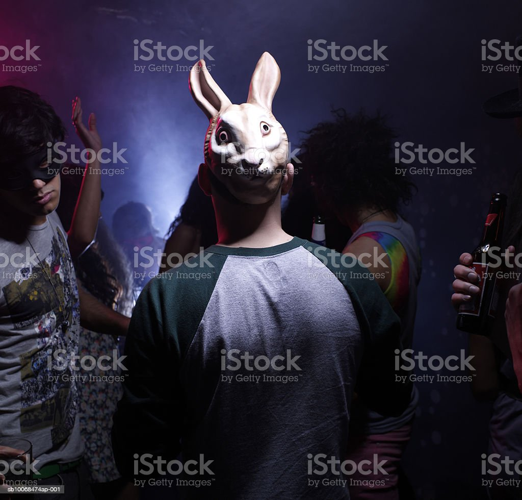 Man in bunny mask dancing in night club royalty-free stock photo