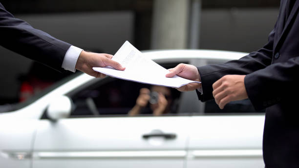 Man in business suit giving secret documents to business partner, information stock photo
