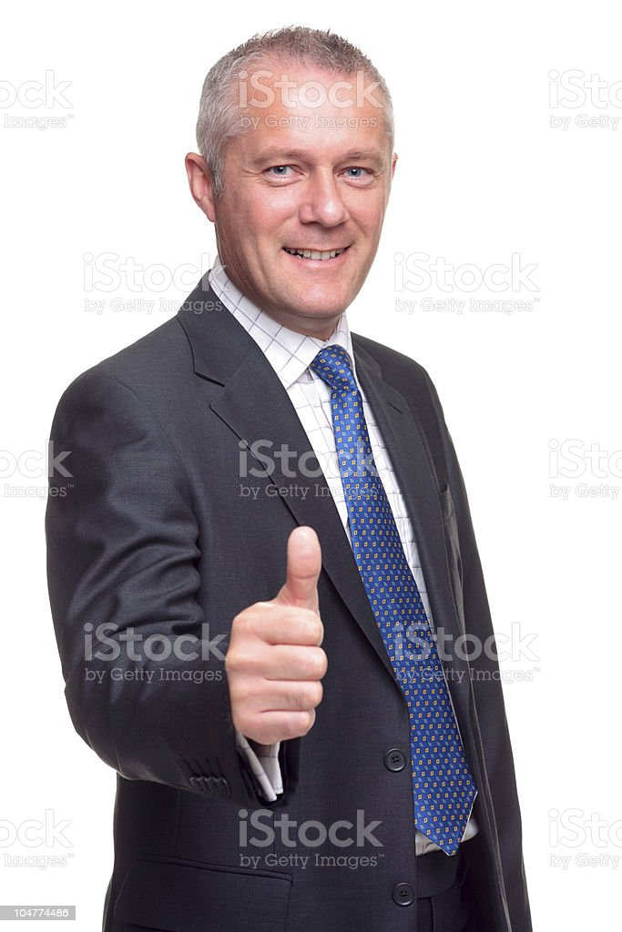 Man in business suit giving thumbs up on white background royalty-free stock photo