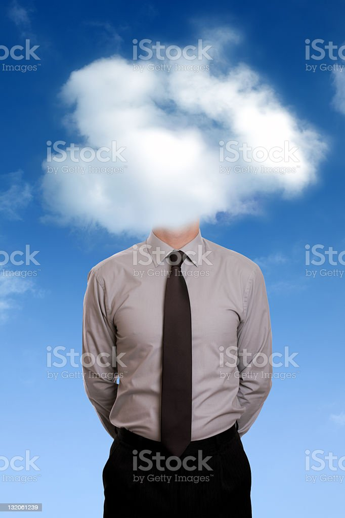Man in business suit has his head covered by clouds stock photo