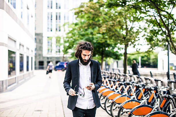 Man in business walking in Central London stock photo