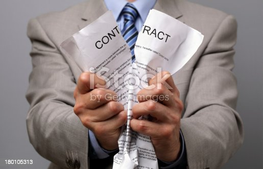94113879istockphoto Man in business wear tearing up a contract with his hands 180105313