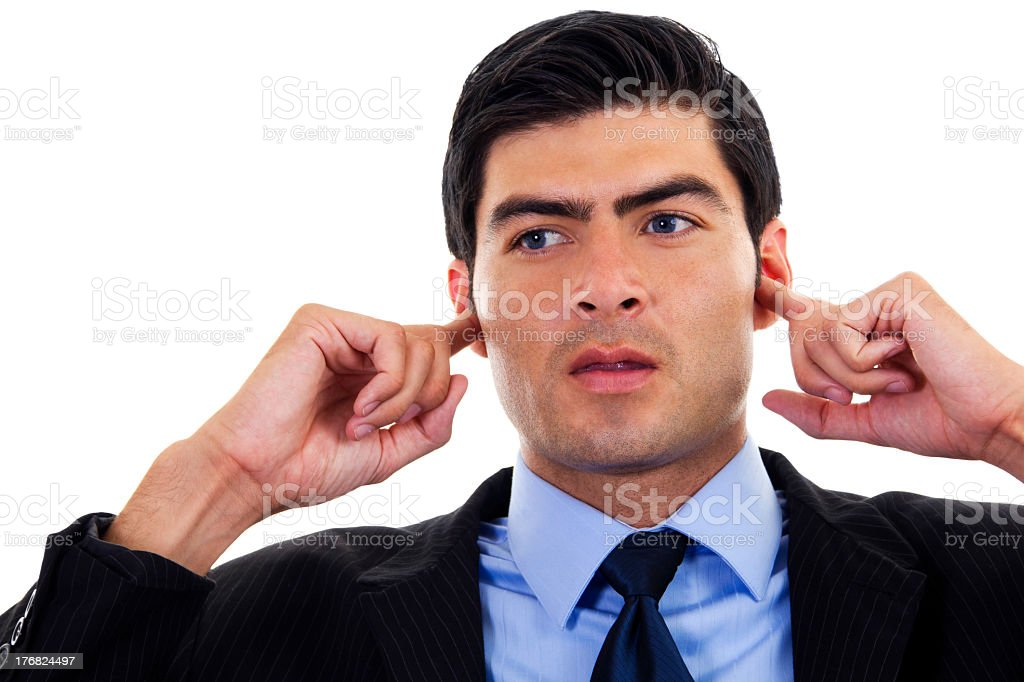 Man in business white covering ears with his fingers stock photo