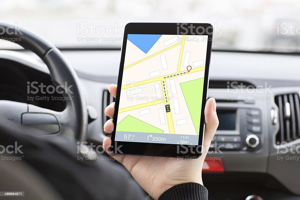 Man In Car And Holding A Tablet With Interface Navigation