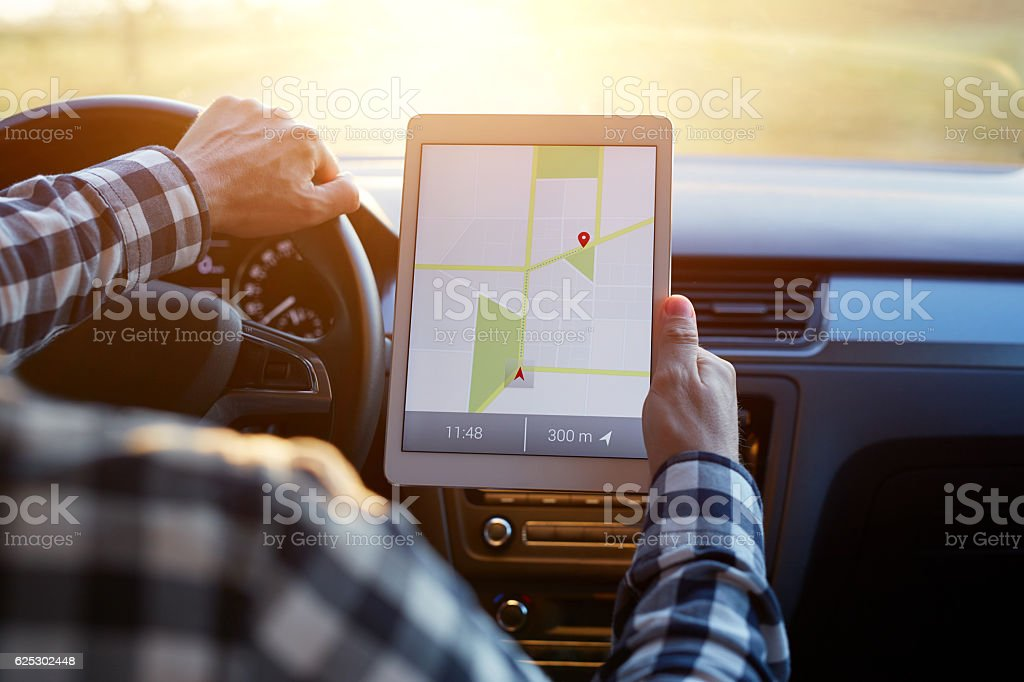 Man In Car And Holding Tablet With Map Gps Navigation Stock