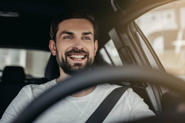 Man in car dealership stock photo