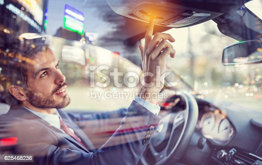 istock Man in car using the car assistance button 625468236