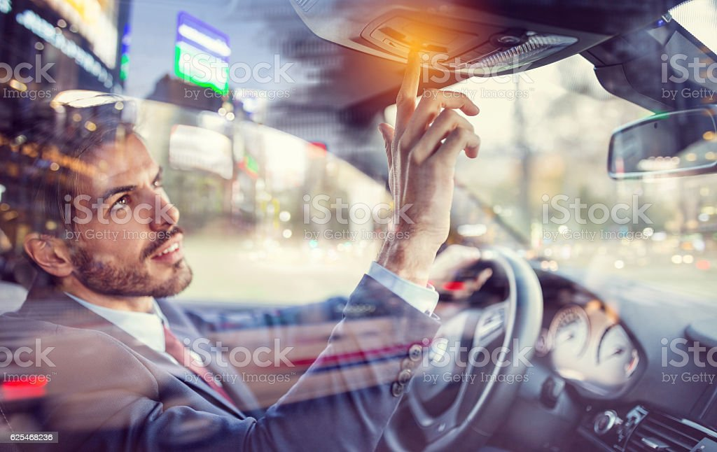 Man in car using the car assistance button stock photo