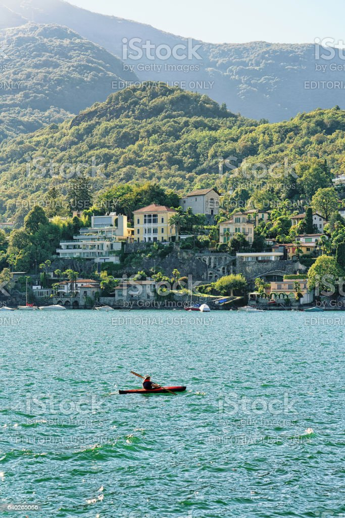 Man in cayak in Ascona on Lake Maggiore stock photo