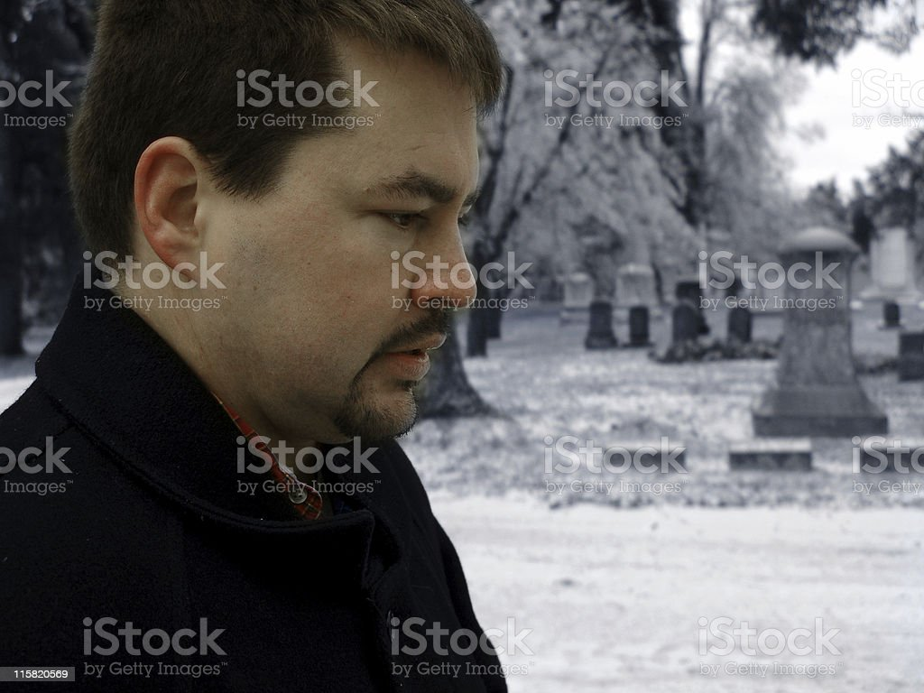 Man in Cemetery stock photo