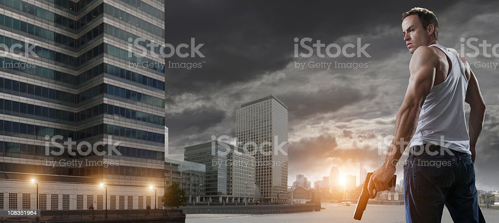 man in city with gun royalty-free stock photo