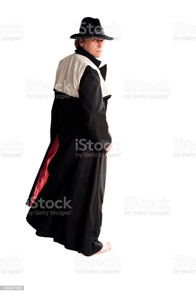 Man in coat and hat stock photo