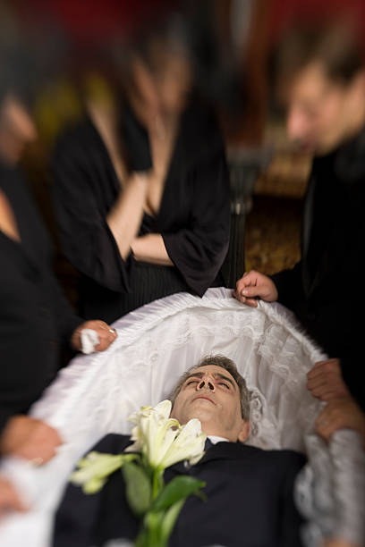 Man in coffin (selective focus) stock photo