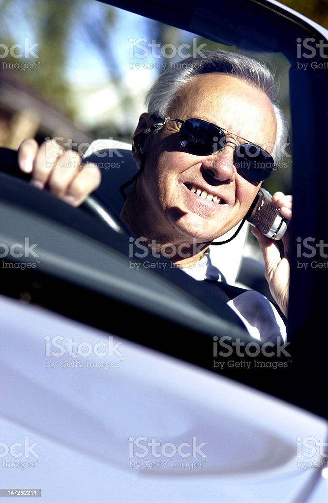 Man in convertible stock photo
